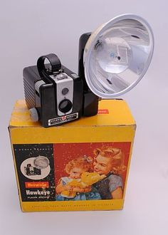 Kodak Brownie Hawkeye flash outfit vintage camera. I remember my parents' Brownie and the little light bulbs you had to buy to take a flash pic.