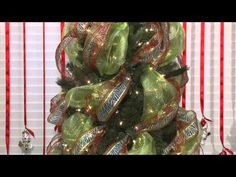 how to decorate the tree with mesh @Heather Haskove this is much easier than what we did...we needed this video last year! Is it to early to put our tree up???