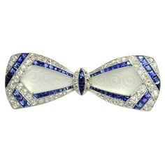 Jackie Kennedy's  Art Deco Diamond Sapphire  Frosted Crystal Bow Brooch For Sale at 1stdibs