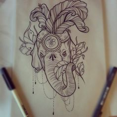 I love the style and detail in this elephant tattoo. Love the feathers, love the chains dangling that are made of dots. Love love love.