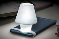 The Travelamp ($8) turns a phone's flashlight into a glowing bedside lamp.