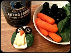 Owl Deviled Eggs using baby spinach, black olives, and carrot pieces as garnish