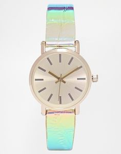 The perfect addition to your Christmas look is obvz an iridescent watch.