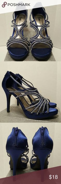"Navy Blue Rhinestone Caged Heels Pre-loved caged heels with rhinestone design.. Back zipper closure..  Size: 6½ Color: Navy Blue Material: Satin Heel height: 4"" Condition: 9 out of 10  ** OFFERS WELCOMED; USING OFFER BUTTON ** Fioni Shoes Heels"