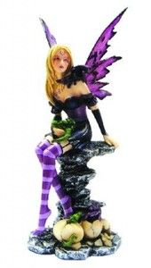 A gothic fairy in vivid purples with a baby dragons around her and hatching from their eggs