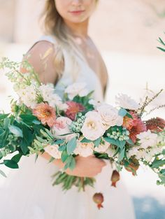 Organic overflowing wedding bouquet: http://www.stylemepretty.com/little-black-book-blog/2016/09/15/sun-filled-engagement-at-sunstone-villa-winery/ Photography: Sally Pinera - http://sallypinera.com/