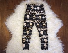 Browse unique items from marysayssew on Etsy, a global marketplace of handmade, vintage and creative goods. Baby Girl Leggings, Halloween Leggings, Skull Print, Baby Prints, Handmade Baby, Black Fabric, Pajama Pants, Hoodies, Trending Outfits
