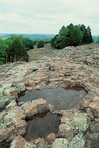 This is an ancient volcano and it has the same octagonal, non basalt pillars as Giants  Causeway in Ireland.  Hughes Mountain | Missouri Department of Conservation