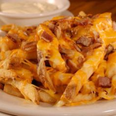Outback Aussie Cheese Fries - Topping: 1 cup shredded monteray jack; 1 cup shredded cheddar; 1 slice Bacon Cooked, crumbled. 1 slice?? Really??
