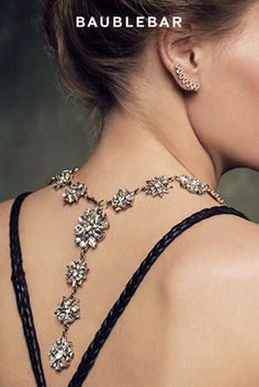 This holiday season, turn heads with a statement necklace that can be worn with an open-back dress or shirt.