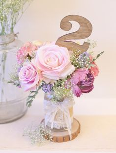 Soft, romantic rustic centerpiece + table number all in one.