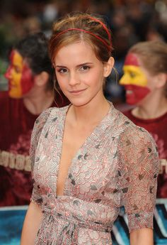 """Emma Watson Messy Updo"" -   Emma accessorized her messy updo with a double-strapped red headband. This simple accessory complemented her heart-printed dress and gave her a sweet and innocent appeal."