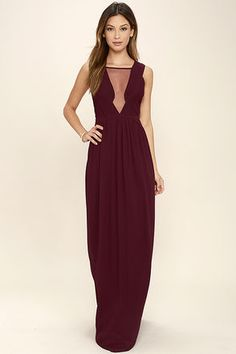 Get ready to stun in the Dazzling Decadence Burgundy Maxi Dress! A pleated, sleeveless bodice with a sexy mesh panel sits atop a flowy maxi skirt. Hidden back zipper with clasp.