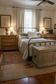 Love the old-world feel. Iron bed, natural elements, wood floor. Country Curtains Catalog, Modern Farmhouse Style, Rustic Farmhouse, Farmhouse Master Bedroom, Home Decor Bedroom, Bedroom Decor Pictures, Bedroom Carpet, Kitchen Furniture, Rustic Furniture