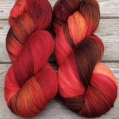 Wanna Go Crazy starts with brilliant red, with dark overtones and flashes of yellowy orange. This colorway can be highly variable, so feel free to give us a call for a current description of what we h