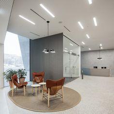 Vääksyntie 2, OP Vallila Campus— JKMM Office Floor, Main Entrance, Large Windows, Facade, Flooring, Building, Interior, Table, Furniture