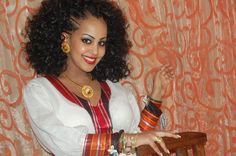 Beautiful Ethiopian woman with a traditional Dress, Hairstyle, and Jewelry. #Divine