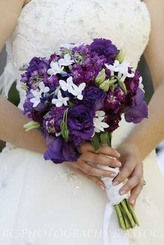 Purple and White, add yellow flowers and this would make the perfect flowers for my wedding