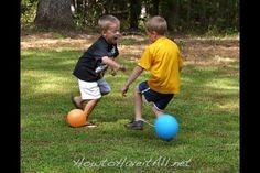 """Balloon Stomp - 1  blown up balloon per guest, plus few extras ties w/ 16"""" lengths string (curling ribbon or yarn etc) Tie to 1 ankle each child.  Children run around trying to """"stomp"""" (pop) everyone else's while keeping theirs intact!  Last Intact balloon wins!"""