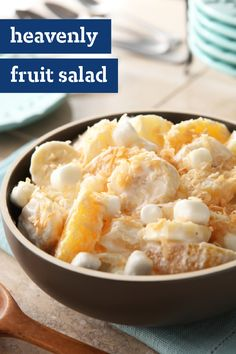 Heavenly Fruit Salad – Banana, pineapple, oranges, and marshmallows blended with creamy mayo and sour cream are served with a sprinkle of coconut for a classic fruit salad recipe.