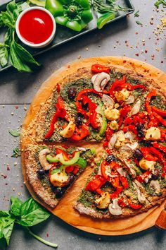 A simple vegan cauliflower pizza crust requiring 9 basic ingredients and easy-to-follow methods. The end product is crispy on the outside, tender on the inside, and perfect for replacing traditional pizza crust!