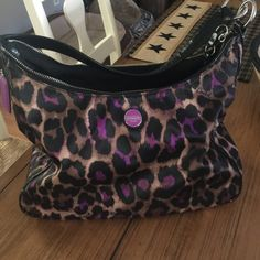 Coach leopard print cute purse! Hardly used Purple and leopard print purse. Hardly used. Basically perfect condition. No stains rips or anything of that sort. Just never use anymore. Bags Shoulder Bags