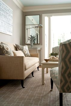OBSESSED with this color palette-- greige walls, blue ceiling, dentil crowning, nailhead trim sofa-- all perfect.