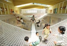 Big net play structure at Yuyu-no-mori Nursery School and Day Nursey in Yokohama City, Japan