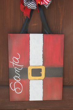 Whimsical Christmas Door Hanger Canvas or wall art.  It can be personalized with your family name also on Etsy, $55.00
