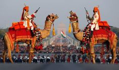 """India's Border Security Force (BSF) soldiers ride their camels as they rehearse for the """"Beating the Retreat"""" ceremony in New Delhi January 27, 2013. The ceremony symbolises retreat after a day on the battlefield, and marks the official end of the Indian Republic Day celebrations. It is held every year on January 29."""