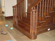 barley twisted newel and balusters under the volute