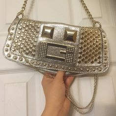 """Silver and gold clutch shoulder bag Gorgeous silver leather clutch with gold accent stuffing and hardware. 3 Gold and silver chains 14"""" from top to bottom for shoulder carrying. Snap closure with 1 inside zipper pocket. Lining clean with no tears. Excellent condition! Very beautiful statement piece! ✨ Guess Bags Clutches & Wristlets"""