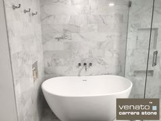 $8.00 a Sq.Ft. Carrara Venato 6x12 Subway Tile was used on this back wall the Carrara Venato has a whiter base than Carrara Bianco, giving a room a brighter appearance.