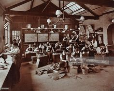 Boys making shoes at the Anerley Residential School for Elder Deaf Boys, Versailles Road, Penge, 1908. Boys at work in the Shoemaker's Shop; pieces of leather lie on the floor in the foreground. The School closed in 1956 on conversion to a school for ?maladjusted children?.