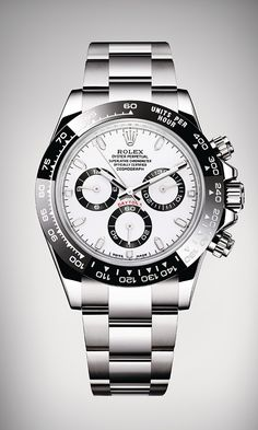 Rolex Cosmograph Daytona in 904L steel, with a black Cerachrom bezel in ceramic, a white dial and an Oyster bracelet.