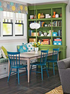 They're used a lot, and for good reason: Banquettes are a great way to add seating and storage to the kitchen, dining room, bedroom, and more. This banquette -- integrated with a tall storage hutch -- offers plenty of seating for a long table yet works well with the shelves for color contrast, too.