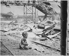 """this picture dated August 28, 1937 is of a terrified baby who was almost the only human being left alive in Shanghai's South Station after brutal Japanese bombing…"""