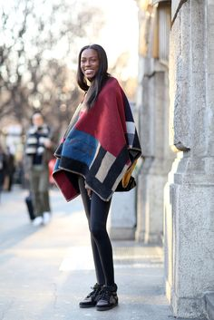 A Burberry-cape spotting, in real life! Down below, a puffy sneaker and some jeggings keep the volume in check.