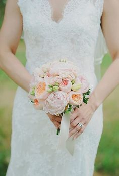 Posy Wedding Bouquet - a small, round bouquet tied with ribbon. A great option for brides that want to showcase their wedding dress. A posy bouquet is appropriate for any wedding style.