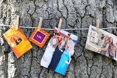 Cute way to display photos at an outdoor baby/bridal shower