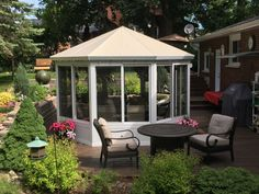 Beautiful Sunroom, Patio Cover, Retractable awning, Aluminum Railing and Aluminum Decking pictures