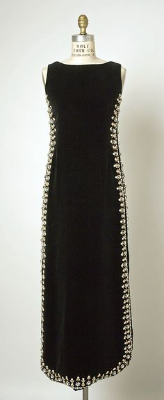 The beading creates a slimming effect.. Balenciaga Beaded Evening Dress, 1967 stunning!