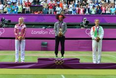 USA's Serena Williams (C), Russia's Maria Sharapova (L) and Belarus' Victoria Azarenka pose with their gold, silver and bronze medals respectively at the end of the women's singles tennis tournament of the London 2012 Olympic Games, at the All England Tennis Club in Wimbledon, southwest London, on August 4, 2012