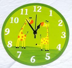 Green Wall Clock With Giraffes Painting by TammnoonyKids on Etsy, $29.90