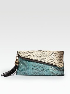 What a stunning clutch - perfect for spring/summer day and night.  This is the first I've ever heard of something made from sea snake.