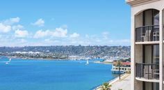 Hilton San Diego Airport/Harbor Island San Diego Overlooking Harbor Island's scenic waterfront, this elegant hotel is 5 minutes' drive from San Diego International Airport. It features free airport shuttles, an outdoor pool and rooms with free Wi-Fi.