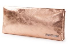"""The Lyra Clutch celebrates the design-motto """"less is more"""", which embodies Gretchen's idea of aesthetic design. The sleek rectangular shape of the body contains an easy and architectural allure that is timelessly modern. Diagonally shaped, the cover flap is accentuated by the profile element which sits underneath the fine waxed calf leather. This delicate detail adds that certain something and provides the Lyra Clutch with a unique message."""