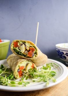 Stuffed with a lemon pepper avocado mash and tender spiced roasted vegetables, these simple springtime avocado garden wraps are an easy and healthy lunch.