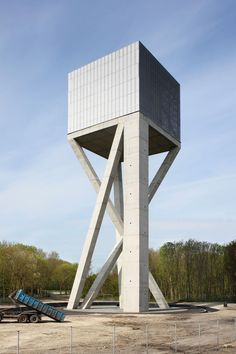 Visions of an Industrial Age: Belgian architecture studio V+ has completed a mesh-covered water tower that is supported by angled concrete columns Architecture Design, Concrete Architecture, Architecture Awards, Contemporary Architecture, Landscape Architecture, Tower Building, Building Design, Concrete Column, Lookout Tower
