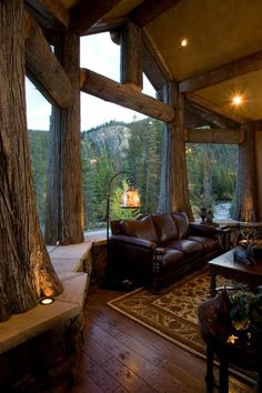 Rustic Living Room with Window seat, Columns, Built-in bench seating, Interior accent lighting, Exposed beam, Hardwood floors
